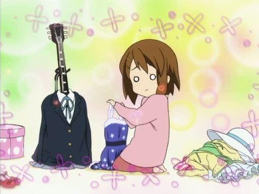 Yui dressing her guitar