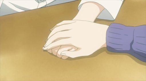Chizu holding Fumi's hand